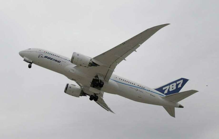Boeings' new 787 Dreamliner takes off from Houston's Bush Intercontinental Airport Thursday, Feb. 3, 2011, in Houston. The plane is one of seven experimental models being tested before the first commercial planes are delivered in late 2011. Photo: Pat Sullivan, AP / AP