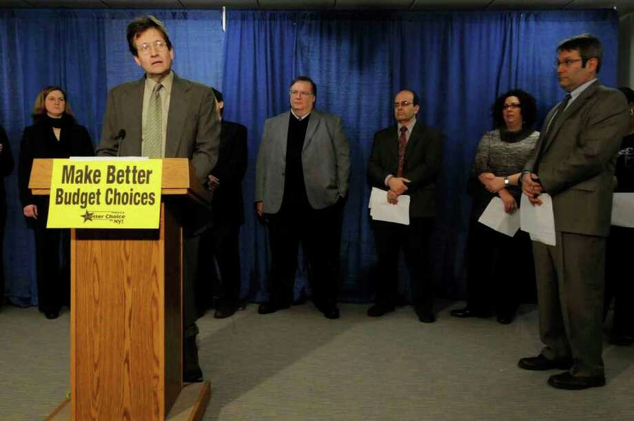 The Rev. Jim Reisner of Albany's Westminister Presbyterian Church speaks during a news conference held by GrowingTogetherNY to address what the group says is harmful cuts in the state budget at the Capitol in Albany Feb. 3,2011.( Michael P. Farrell/Times Union ) Photo: Michael P. Farrell