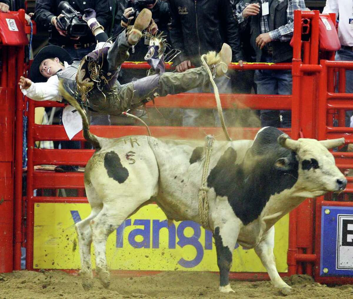 Steve Woolsey, from Payson, Utah, is thrown off his bull in the Xtreme Bulls event at AT&T Center.