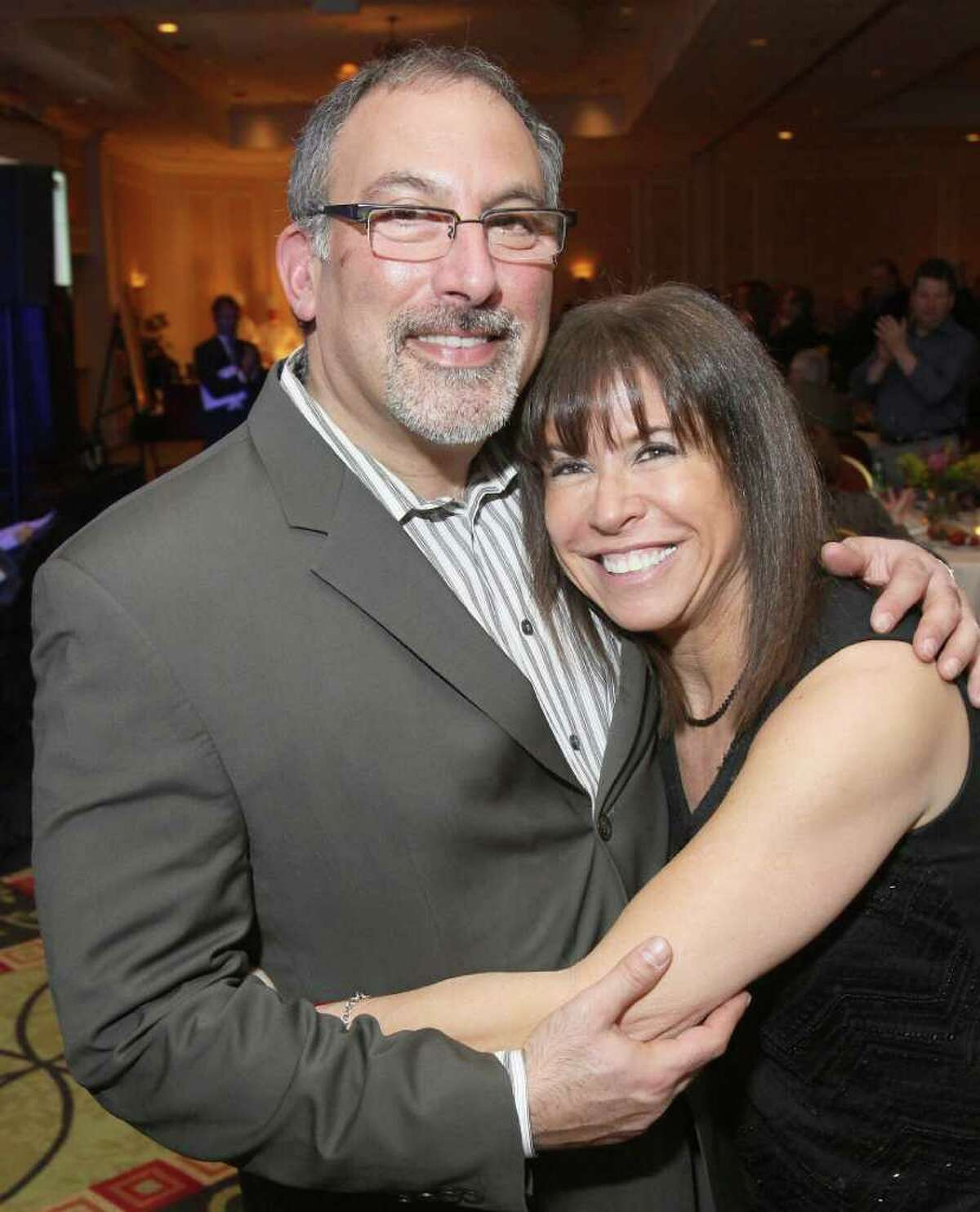 Alan Greenberg and Susan Ungerman get cozy on the dance floor during Taste of Compassion, a Jan. 28, 2011, wine tasting event to benefit the Leukemia & Lymphoma Society Upstate New York/Vermont Chapter. (Joe Putrock / Special to the Times Union)