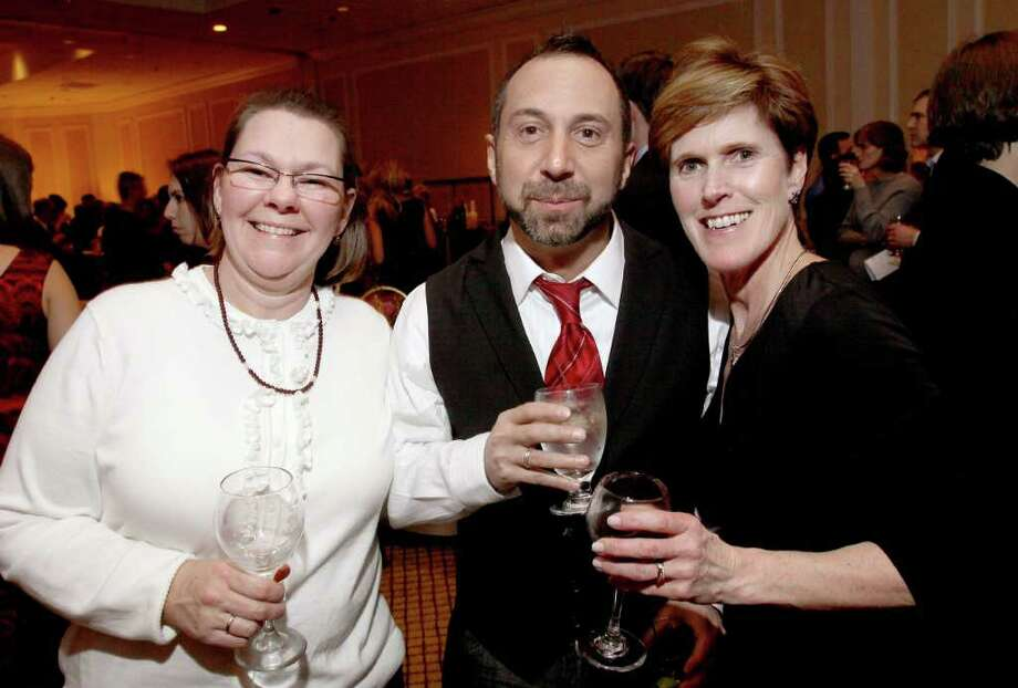 From left: Joy McAlister, Michael Taglione and Nancy Meyer during Taste of Compassion, a Jan. 28, 2011, wine tasting event to benefit the Leukemia & Lymphoma Society Upstate New York/Vermont Chapter. (Joe Putrock / Special to the Times Union) Photo: Joe Putrock / Joe Putrock