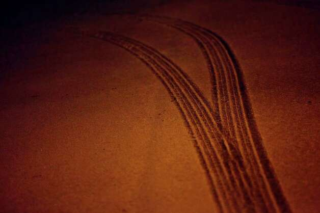 METRO - Tire tracks through the snow onto Fredericksburg Road in San Antonio early Friday, Feb. 4, 2011. LISA KRANTZ/lkrantz@express-news.net Photo: LISA KRANTZ, SAN ANTONIO EXPRESS-NEWS / SAN ANTONIO EXPRESS-NEWS