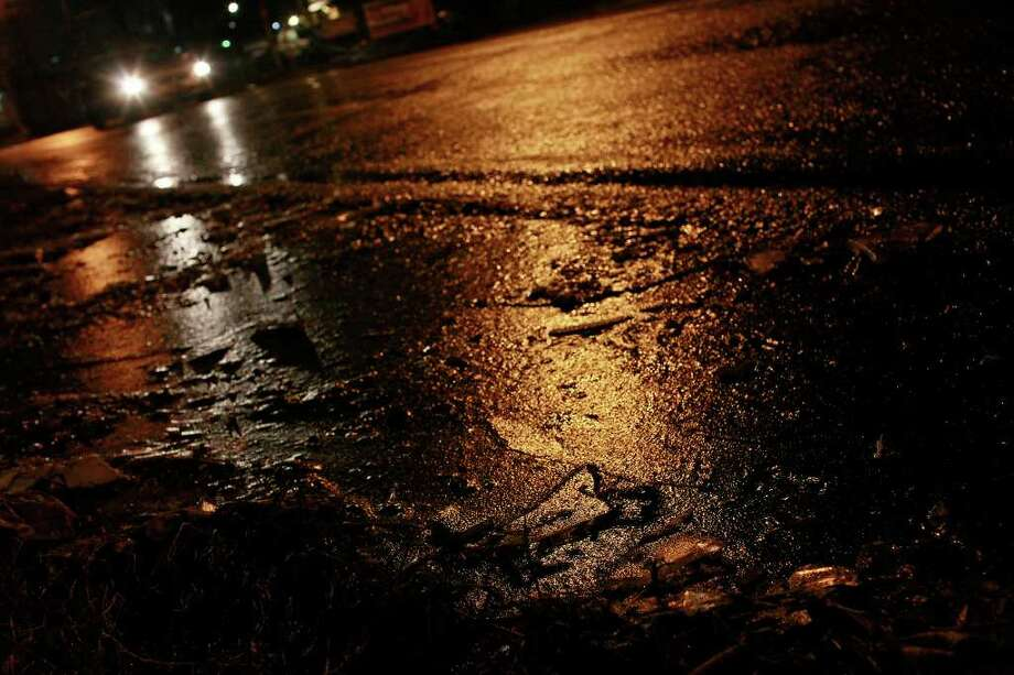 METRO - Ice forms on the side of Fredericksburg Road as drivers navigate icy conditions on Fredericksburg Road near the intersection with I-10 in San Antonio late Thursday, Feb. 3, 2011. LISA KRANTZ/lkrantz@express-news.net Photo: LISA KRANTZ, SAN ANTONIO EXPRESS-NEWS / SAN ANTONIO EXPRESS-NEWS