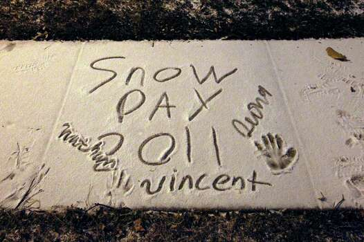 The first snow event of the year in San Antonio is scribbled on a sidewalk along Tioga street on the city's Northside on Friday, Feb. 4, 2011. Kin Man Hui/kmhui@express-news.net Photo: KIN MAN HUI, SAN ANTONIO EXPRESS-NEWS / San Antonio Express-News
