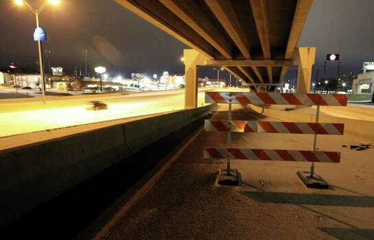 A barricade is placed on the entrance ramp to IH-10 westbound near Wurzbach Road as the first snow and ice event in San Antonio forced closures of roads and highways around town in the early hours of Friday, Feb. 4, 2011. Kin Man Hui/kmhui@express-news.net Photo: KIN MAN HUI, SAN ANTONIO EXPRESS-NEWS / San Antonio Express-News