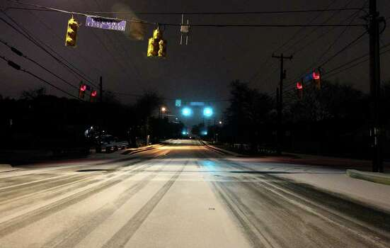 The intersection of Colony Drive and Vance Jackson Road is covered with snow and ice during the year's first snow event in San Antonio in the early morning hours of Friday, Feb. 4, 2011. Kin Man Hui/kmhui@express-news.net Photo: KIN MAN HUI, SAN ANTONIO EXPRESS-NEWS / San Antonio Express-News