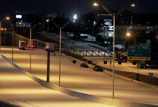 Cars and commercial haulers sit idle along IH-10 eastbound near Callaghan Road as snow and ice forced closures of streets and highways in San Antonio during the early morning hours of Friday, Feb. 4, 2011. Kin Man Hui/kmhui@express-news.net Photo: KIN MAN HUI, SAN ANTONIO EXPRESS-NEWS / San Antonio Express-News