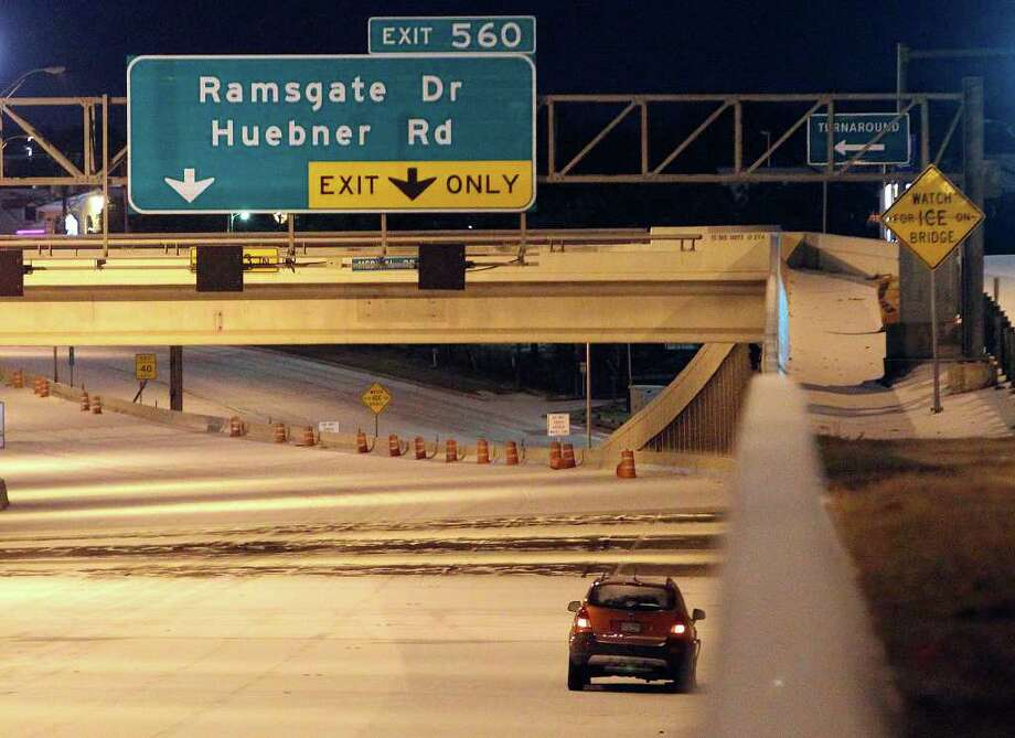 A vehicle sits idle along IH-10 westbound near Wurzbach Road as the year's first snow event in San Antonio shut down roads and forced motorists off the slick streets in the early morning hours of Friday, Feb. 4, 2011. Kin Man Hui/kmhui@express-news.net Photo: KIN MAN HUI, SAN ANTONIO EXPRESS-NEWS / San Antonio Express-News