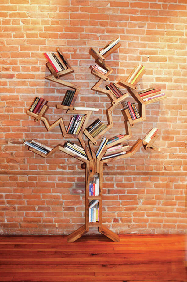 "Fine furniture maker Jim Smith creates materpieces of functional art from his woodworking shop in Schuylerville. Pictured above, Smith's modifiable book tree, ""fiction-non."" (Krishna Hill/Life@Home) Click here to read the story."