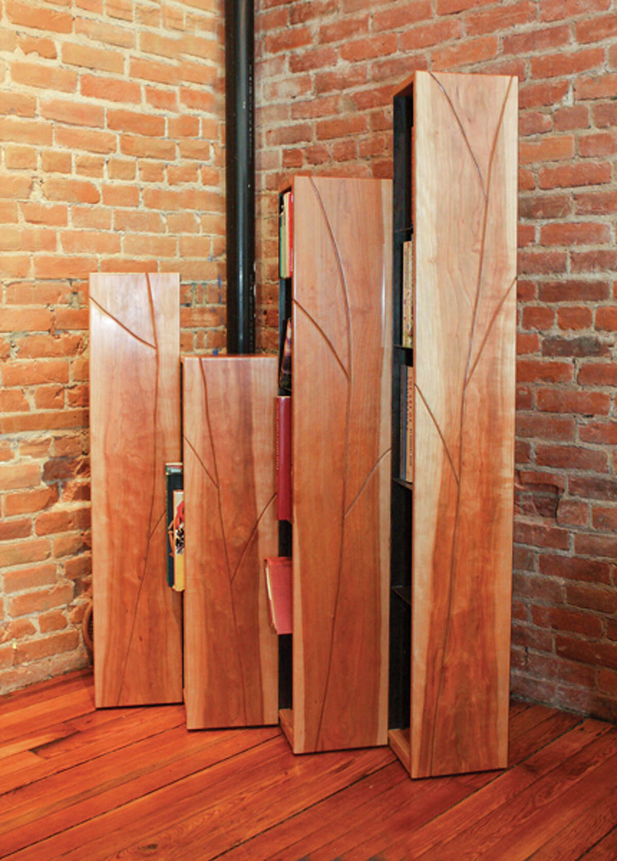 Fine furniture maker Jim Smith creates materpieces of functional art from his woodworking shop in Schuylerville. Pictured above, Smith's hinged, foldable set of bookcases,