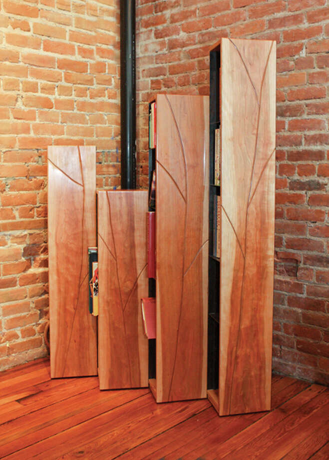 "Fine furniture maker Jim Smith creates materpieces of functional art from his woodworking shop in Schuylerville. Pictured above, Smith's hinged, foldable set of bookcases, ""Of Seed and Stone."" (Krishna Hill/Life@Home) Click here to read the story."