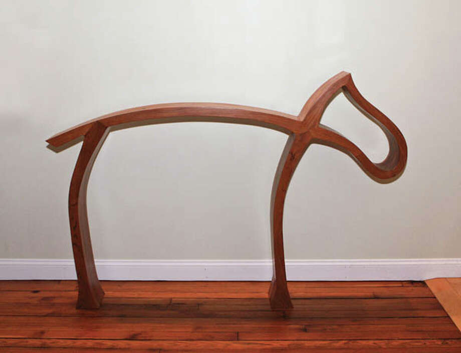Fine furniture maker Jim Smith creates materpieces of functional art from his woodworking shop in Schuylerville. (Krishna Hill/Life@Home) Click here to read the story.