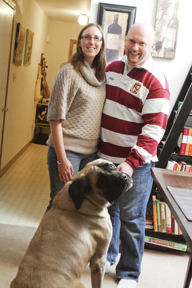 The art of charcuterie ? producing cured cold meat such as bacon, sausage, p??and confit ? is the delicious specialty of chef Christopher Allen Tanner, a member of the culinary faculty at Schenctady County Community College. Pictured above, Jessica and Christopher Allen Tanner, along with their dog, Minus. (Suzanne Kawola/Life@Home) Click here to read the story.