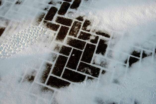 Snow is seen on a section of brick pavers near the Alamo Friday morning Feb. 4, 2011. Photo: WILLIAM LUTHER, Wluther@express-news.net / © 2011 San Antonio Express-News