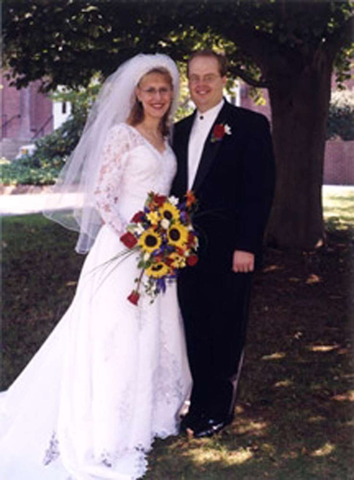 Amy and Jason Davis were married Sept. 25, 1999 in Branford. The couple met when Jason was a student at Western Connecticut State University in Danbury. Amy graduated from WestConn a year after he did.