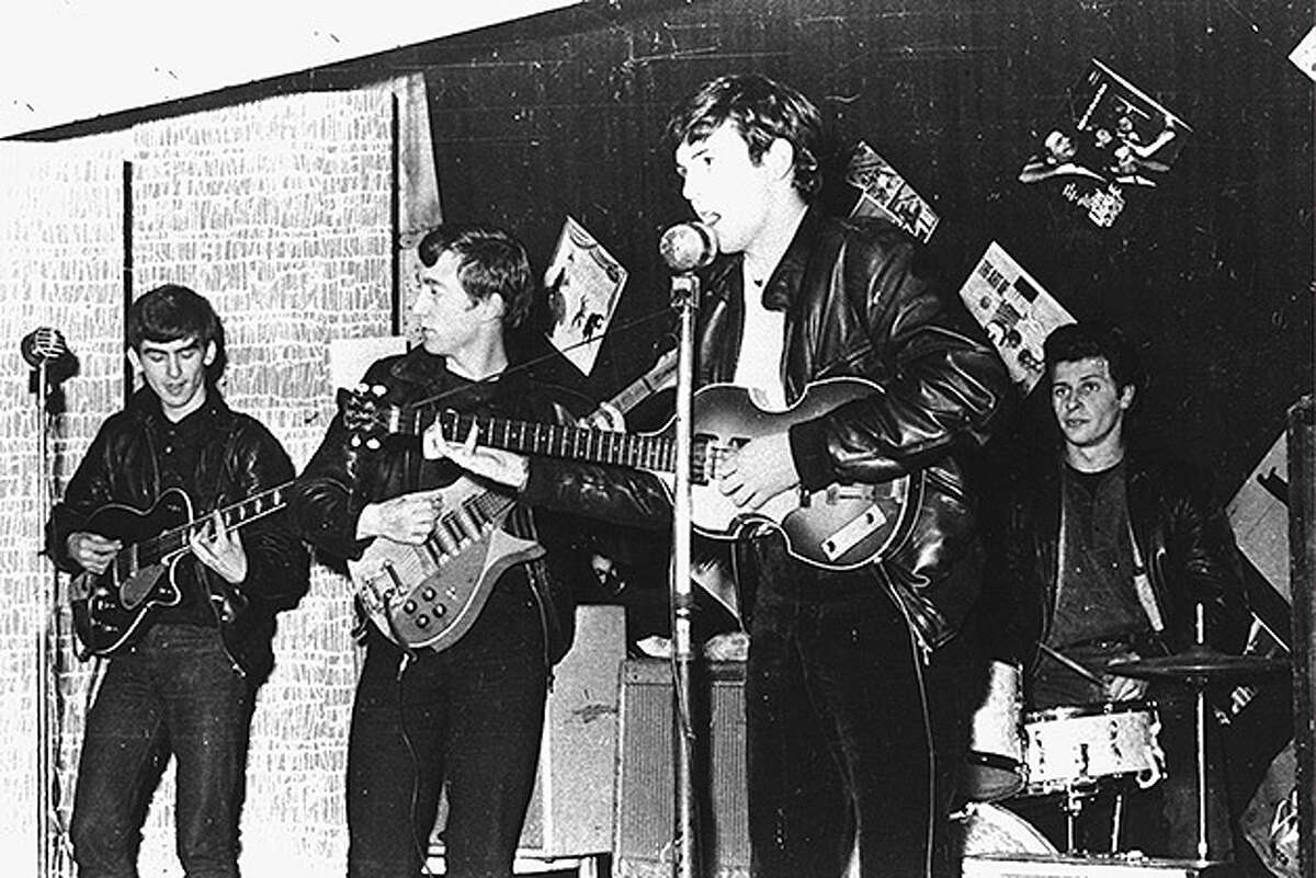 British rock group The Beatles perform in a club prior to signing their first recording contract, Liverpool, England, 1962. L-R: George Harrison, John Lennon, Paul McCartney, and original drummer Pete Best.