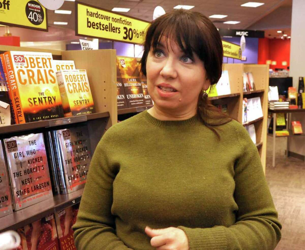 Karen Petras, store manager of Borders in the Southbury Plaza, discusses the area, Friday, Jan. 28, 2011.