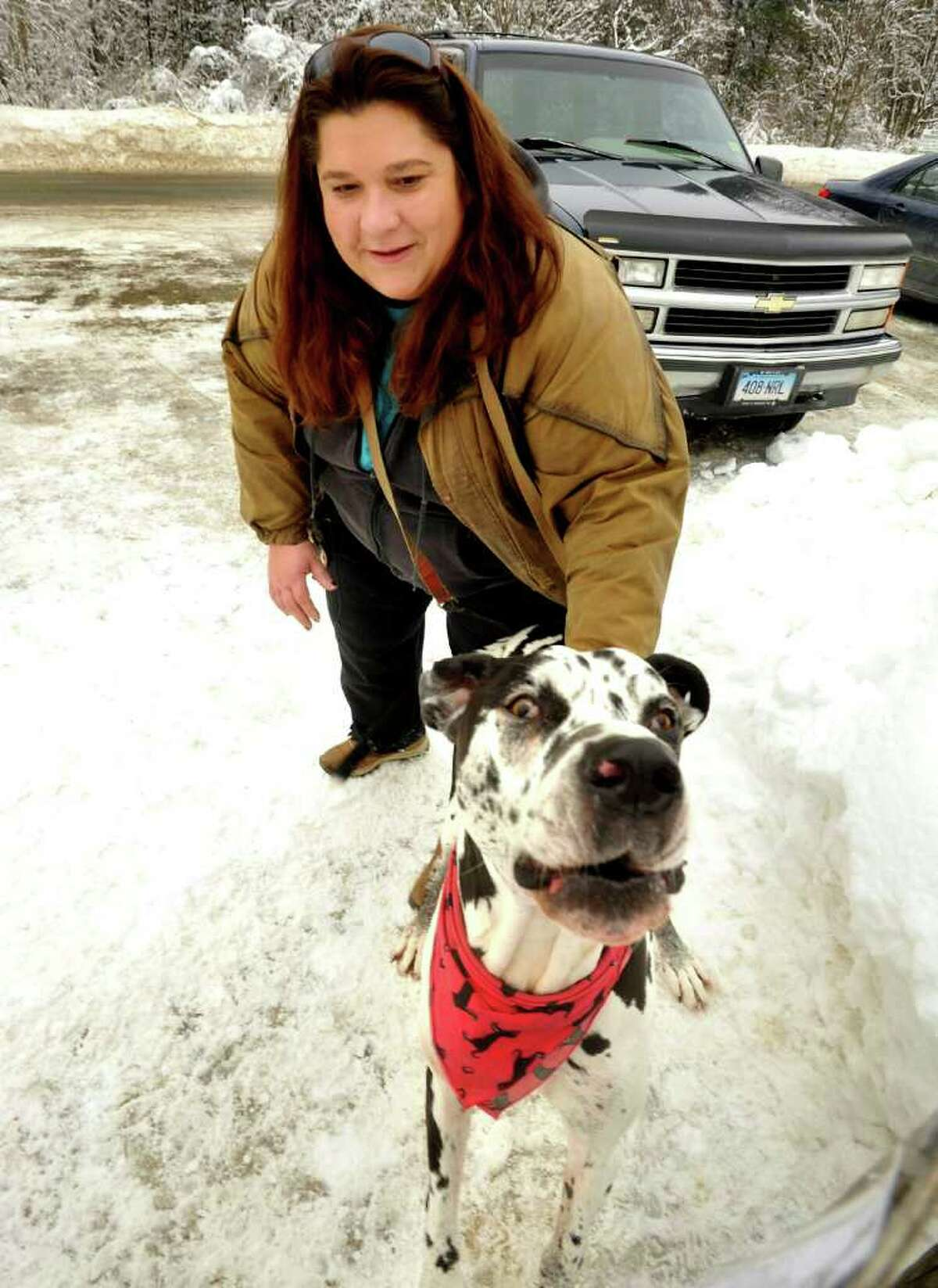 Kathy Ruddy, of Monroe, holds her dog, Caesar at the Southbury dog park, Friday, Jan. 28, 2011.