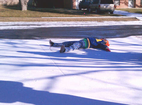 An attempt to make a snow angel in North Central San Antonio on Feb. 4, 2011. Photo: Glenda Wolin, San Antonio Express-News