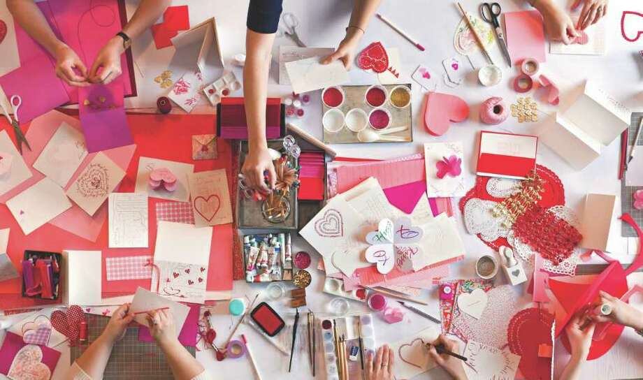Making homemade Valentine's Day cards. Editorial feature in February 2011 issue of Martha Stewart Living. Credit: Martha Stewart Living Photo: Photographer: Gemma Hart Ingalls / DirectToArchive