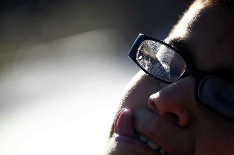 "METRO - ""I need windshield wipers,"" Efren Sanchez says after snow got inside his glasses during a snowball fight with his family as he tries to lick ice off his cheek outside his home in San Antonio on Friday, Feb. 4, 2011. LISA KRANTZ/lkrantz@express-news.net Photo: LISA KRANTZ, SAN ANTONIO EXPRESS-NEWS / SAN ANTONIO EXPRESS-NEWS"
