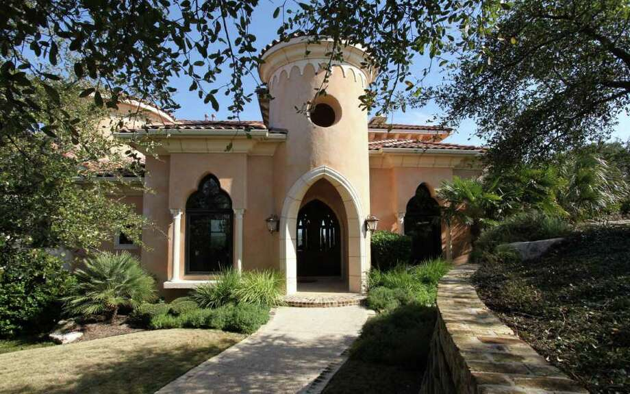 Many of the homes in The Dominion have a Mediterranean look, such as this home with arched entryways and high ceilings, listed at $2.8 million. Courtesy Photo: COURTESY PHOTO / Photos courtesy of Kuper Sotheby's International Realty