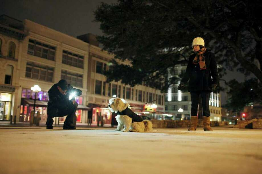 "FOR METRO - Jonathan Huhn photographs Alejandra Baptista and her dog ""Bauer"" in Alamo Plaza early Friday Feb. 4, 2011 after a dusting of snow. (PHOTO BY EDWARD A. ORNELAS/eaornelas@express-news.net) Photo: EDWARD A. ORNELAS, SAN ANTONIO EXPRESS-NEWS / eaornelas@express-news.net"