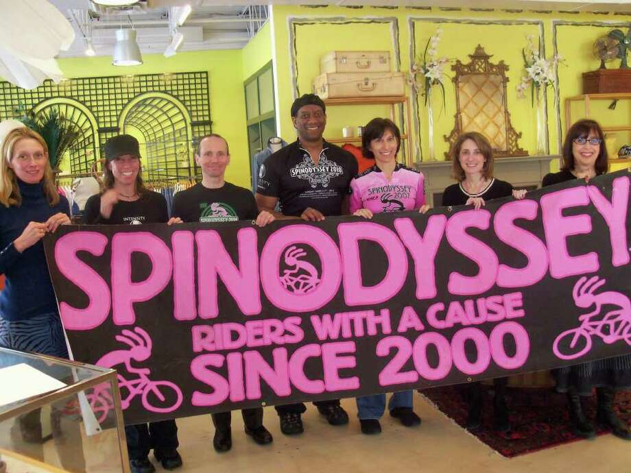 "From left, Samantha Holmes, general manager of J. McLaughlin in Westport; Clair Mason, co-owner of Intensity in Norwalk; Spinodyssey committee member Norm Trepner; Butch Quick of Spinodyssey; Judy Samuels of Spinodyssey; Gayle Alswanger of the American Cancer Society; and Shelly Kassen, Second Selectman of the Town of Westport, on Friday convened at the J. McLaughlin Store lat 1026 Post Road East in Westport to discuss the store's upcoming ""Sip and Shop"" fundraiser.  From 4 p.m. to 7 p.m. on Saturday, February 12, the J. McLaughlin store in Westport will donate 15 percent of all purchases to Spinodyssey. Photo: Contributed Photo / Westport News contributed"