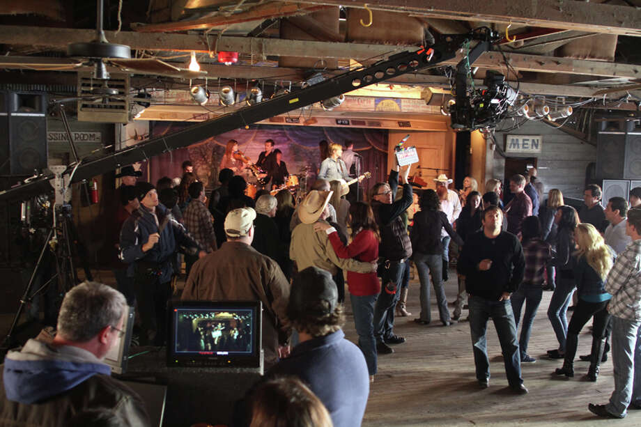 A film crew captures country singer Jack Ingram at Gruene Hall performing a song commissioned by H-E-B. The grocery company featured the song in a 60-second ad during the Super Bowl. / Copyright 2011 Mark Langford Photography, Inc.
