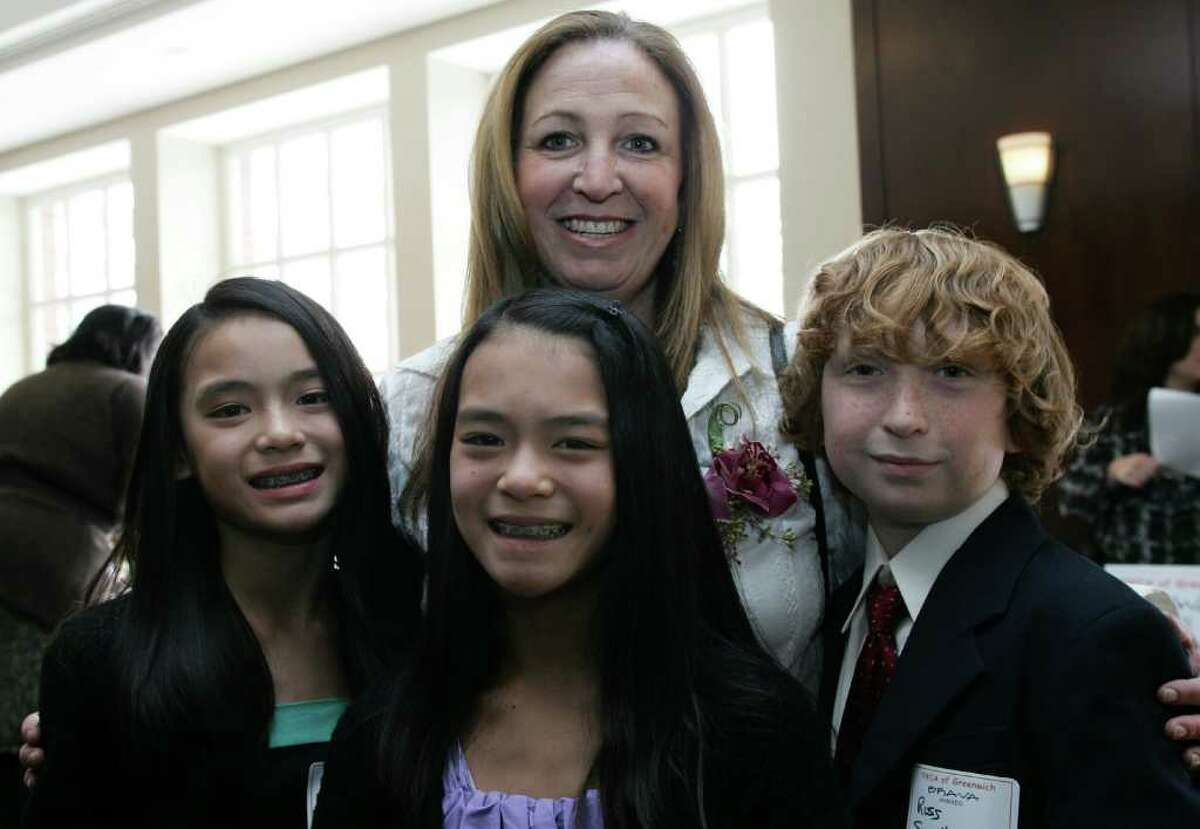 2011 BRAVA Award winner Donna Adelberg-Spellman with her children, from left, Jennie, Caitlin and Ross before the start of the awards ceremony held at the Hyatt Regency Greenwich Friday afternoon.