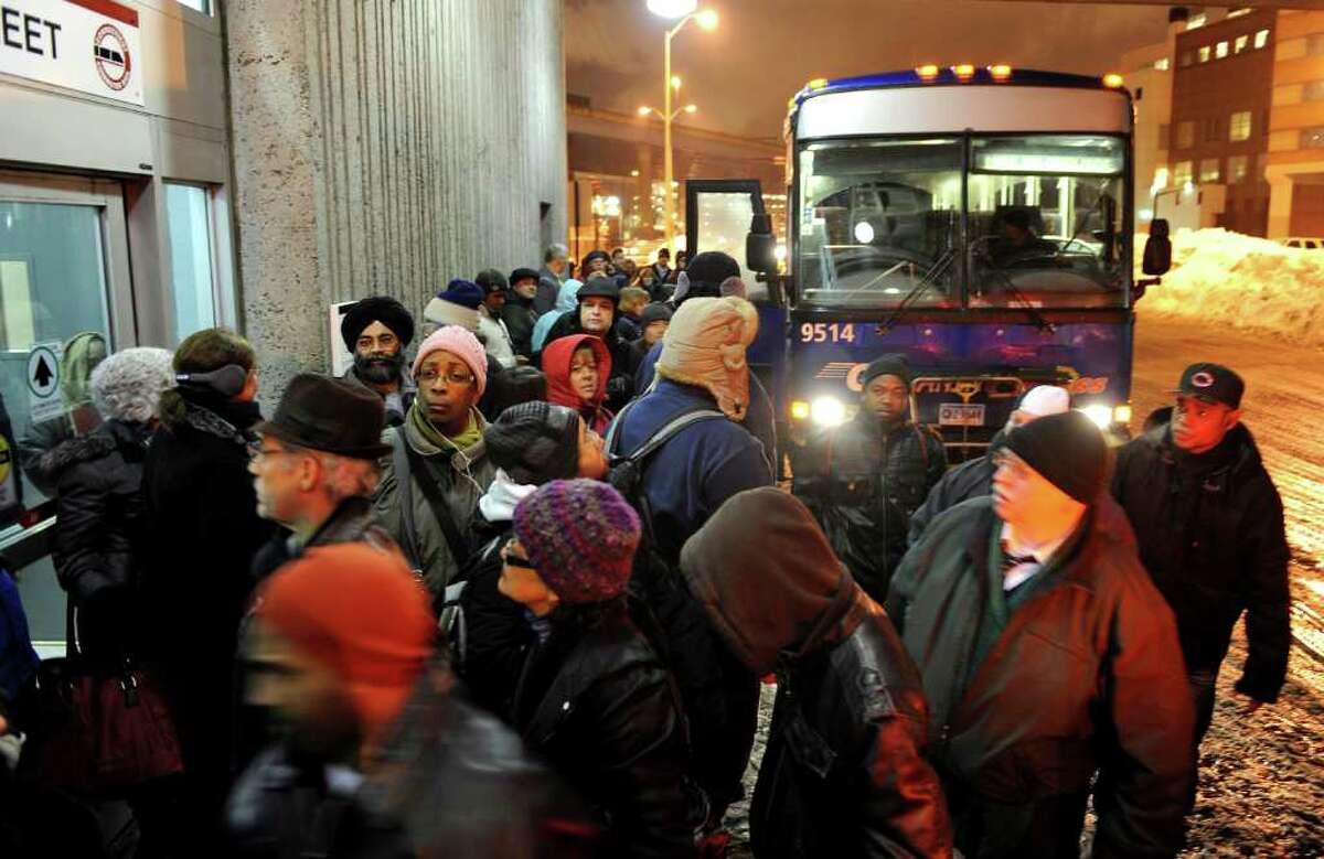 Due to the train service to Waterbury being halted, due to the icey conditions, dozens of commuters wait to board one of three coach buses that arrived at the commuter terminal in downtown Bridgeport, Conn. on Tuesday February 1, 2011.