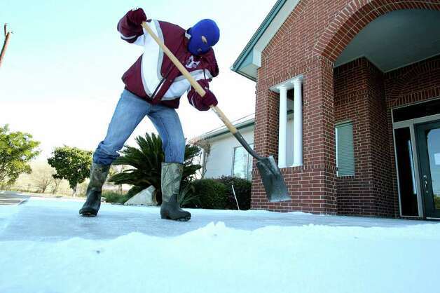 METRO   Steve Furney uses a shovel to clear the entry way to the Today's Smile dental clinic where his wife Dr. Suzan Furney practices as snow accumulation shows in the New Braunfels area on February 4, 2011. Tom Reel/Staff Photo: TOM REEL, SAN ANTONIO EXPRESS-NEWS / © 2010 San Antonio Express-News