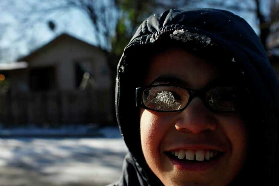 """METRO - """"I need windshield wipers,"""" Efren Sanchez says after snow got inside his glasses during a snowball fight with his family in San Antonio on Friday, Feb. 4, 2011. LISA KRANTZ/lkrantz@express-news.net Photo: LISA KRANTZ, SAN ANTONIO EXPRESS-NEWS / SAN ANTONIO EXPRESS-NEWS"""