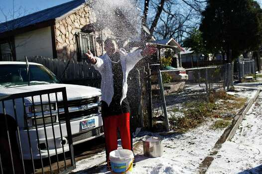 """METRO - """"I don't know how to make a snowman, I've never been around ice before,"""" Ramon Alonso, 16, says upon his decision to have a snowball fight instead as he enjoys the snow with his family in San Antonio on Friday, Feb. 4, 2011. LISA KRANTZ/lkrantz@express-news.net Photo: LISA KRANTZ, SAN ANTONIO EXPRESS-NEWS / SAN ANTONIO EXPRESS-NEWS"""