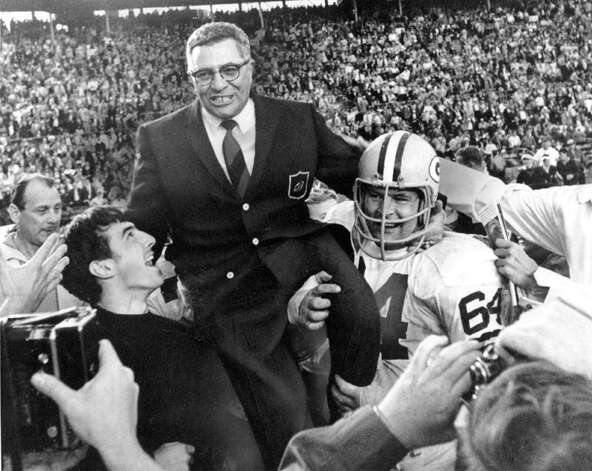 Green Bay Packers coach Vince Lombardi is carried off the field after his team defeated the Oakland Raiders 33 to 14 in the Super Bowl II game in Miam