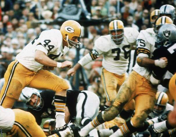 Green Bay Packers runningback #44 Donny Anderson Finds a hole in the Oakland Raiders defence and scores a touchdown during Super Bowl II at the Orange Bowl in Miami, Fla., on Sunday, Jan. 14, 1968. (AP Photo)
