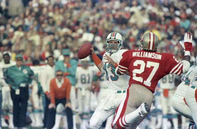 Dan Marino, quarterback for the Miami Dolphins, looks for