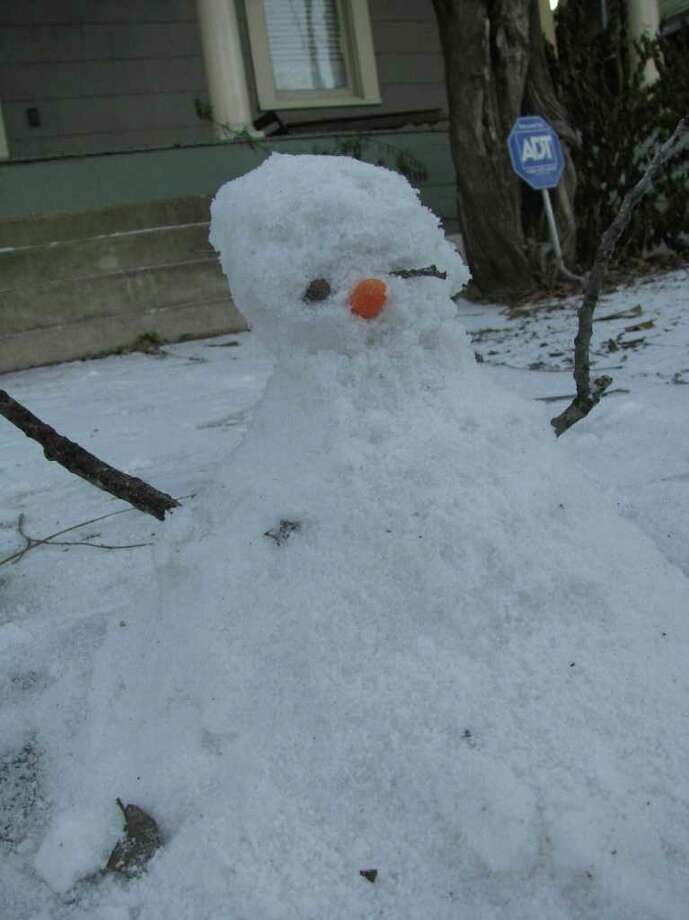A snowman is seen in the King William District on Friday, Feb. 4, 2011. Photo: Michael Quintanilla