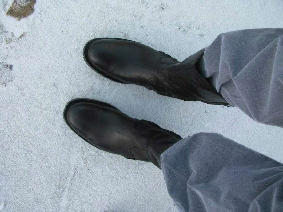 It was boot weather for sure in the King William District on Friday, Feb. 4, 2011. Photo: Michael Quintanilla