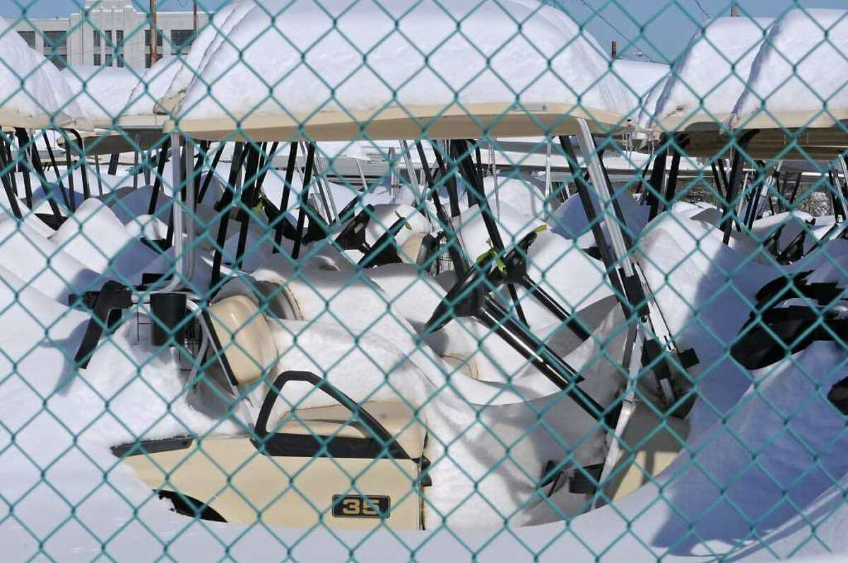 Snow-covered golf carts in Menands, NY, on February 4, 2011. (Lori Van Buren / Times Union)