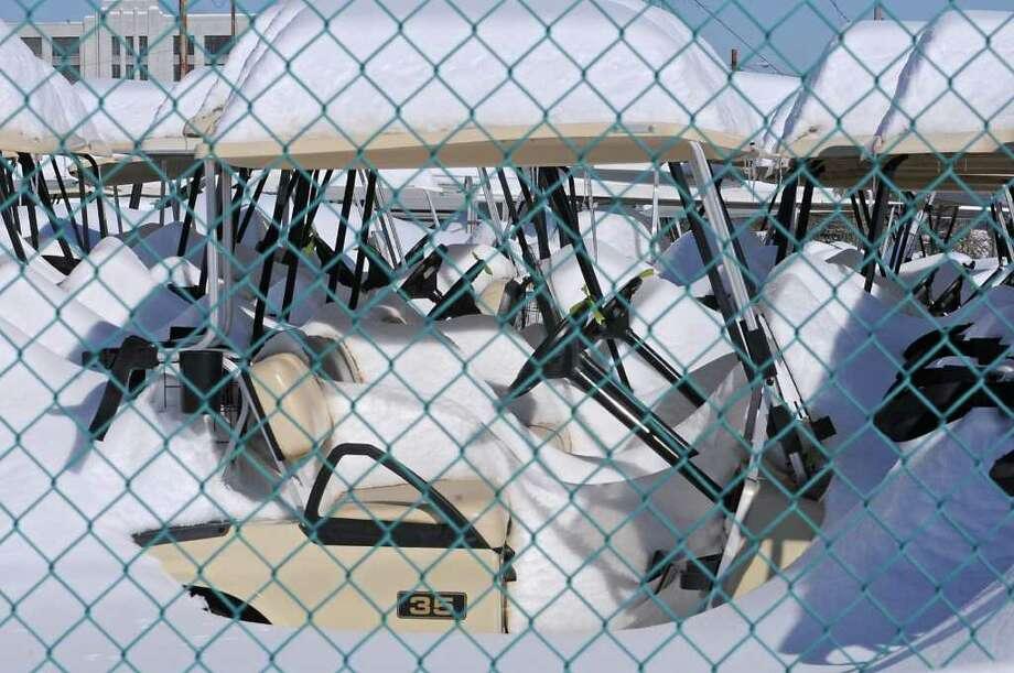 Snow-covered golf carts in Menands, NY, on February 4, 2011.  (Lori Van Buren / Times Union) Photo: Lori Van Buren