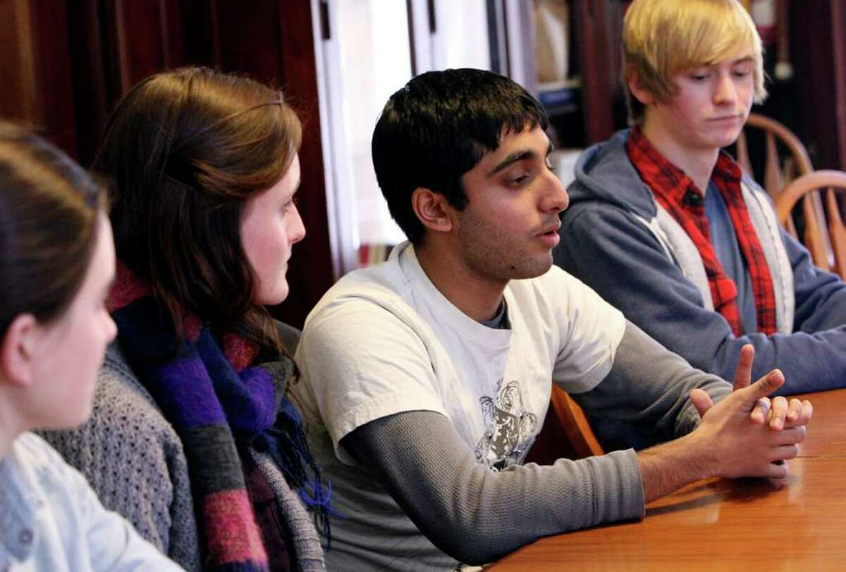 Ellen Marie Andrews (from left), 15; Amy Robinson, 18; Mikail Kahn 17; and Myles Cooper, 16, students from Keystone School, discuss the decision by TAPPS to reject an Islamic school that had applied for membership.