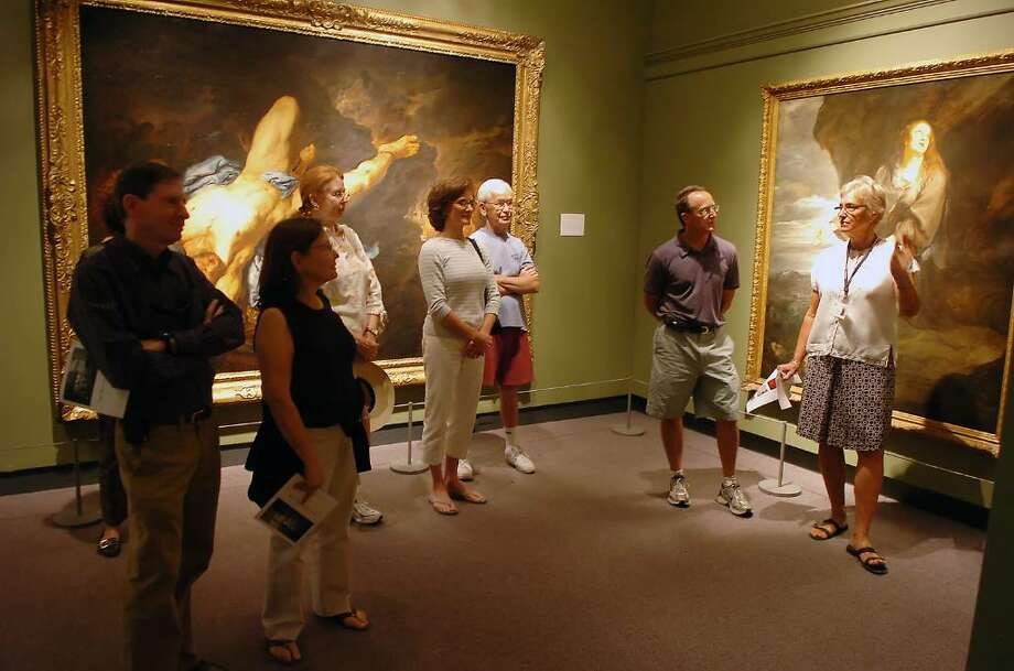 """Docent Wendy Moldovan, right, leads a tour through the Bruce Museum's """"Masterpieces of European Painting from Museo De Arte De Ponce"""" on Friday afternoon, Sept. 4, 2009. Despite the economic downturn the Bruce Museum's attendance is consistent with this time last year which some visitors attributed to the budget friendly programs. This show closes Sunday, Sept. 6, 2009. Photo: Keelin Daly / Greenwich Time"""