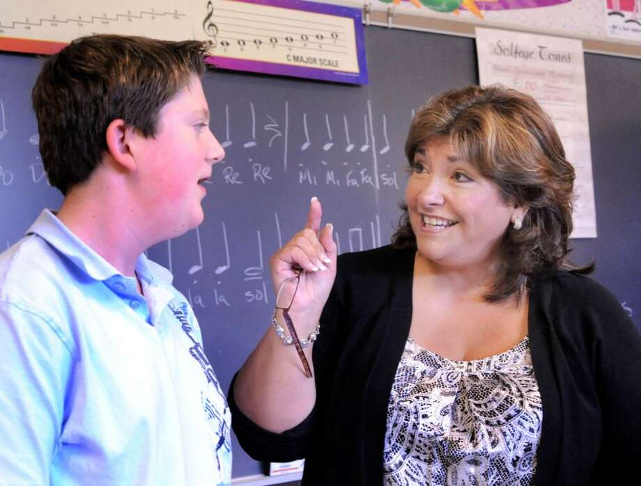 Danbury's Teacher of the Year, Connie Swanson, tests the voice of Justin Gotthardt, 12, in 7th grade Chorus class at Broadview Middle School on Monday, Dept. 14, 2009. Photo: Michael Duffy / The News-Times