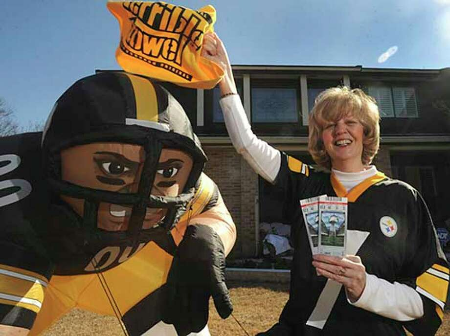 Kim Schmeck, a native of Pittsburg now living in San Antonio, will be attending the Super Bowl with her son and plans to cheer on her beloved Steelers on their battle against the Green Bay Packers.  -Billy Calzada/ Express-News