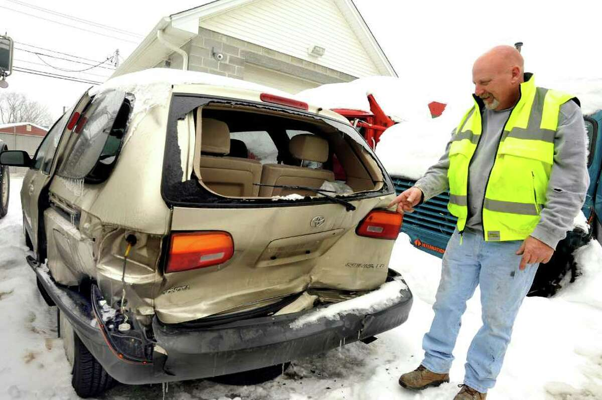 Tom Hall, of Modzelewski's Auto Body Works in Danbury, talks about snow-related wrecks on Saturday, Feb. 5, 2011.