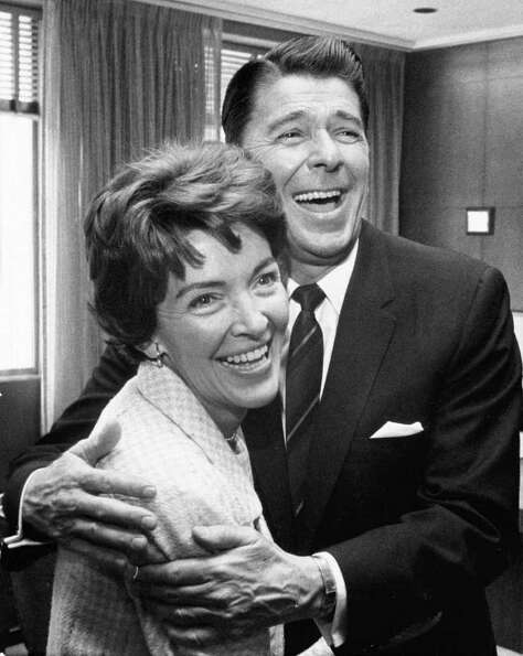 402010 02: Former U.S. President Ronald Reagan and First Lady Nancy Reagan share a laugh in this und