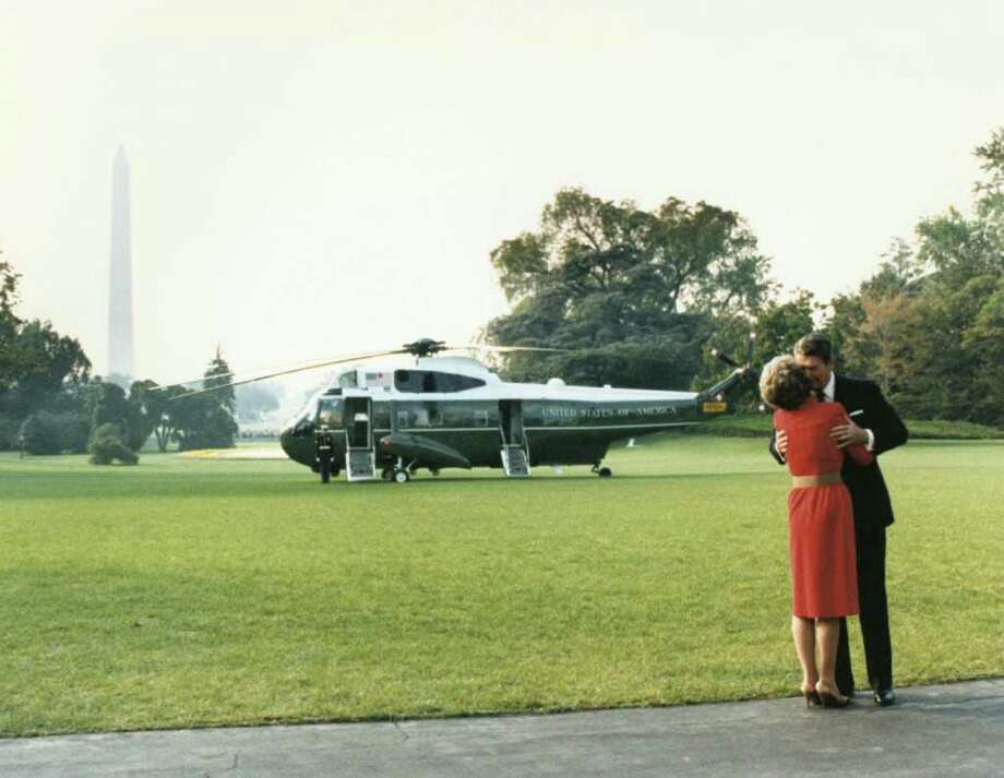 402010 04: Former U.S. President Ronald Reagan kisses former First Lady Nancy Reagan in this undated file photo. The couple celebrated their 50th wedding anniversary on March 4th 2002. (Photo courtesy Ronald Reagan Presidental Library/Getty Images) Photo: Getty Images / Getty Images