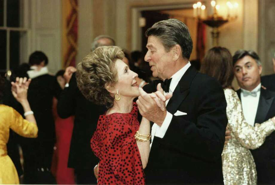 402010 05: Former U.S. President Ronald Reagan dances with former First Lady Nancy Reagan in this undated file photo. The couple celebrated their 50th wedding anniversary on March 4th 2002. (Photo courtesy Ronald Reagan Presidental Library/Getty Images) Photo: Getty Images / Getty Images