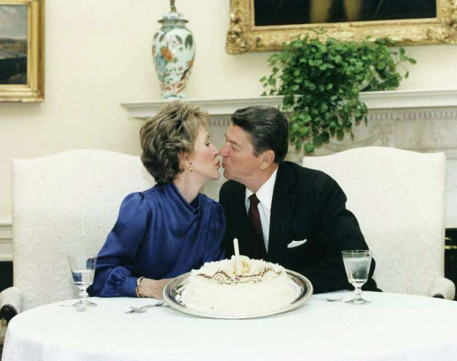 402010 07: Former U.S. President Ronald Reagan kisses former First Lady Nancy Reagan in this undated file photo. The couple celebrated their 50th wedding anniversary on March 4th 2002. (Photo courtesy Ronald Reagan Presidental Library/Getty Images) Photo: Ronald Reagan Library, Getty Images / Getty Images